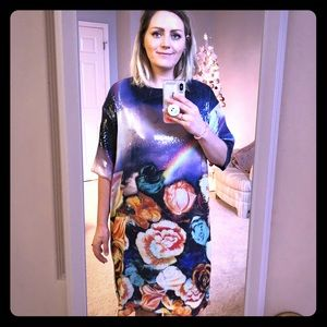 Shiny black dress with flowers and a rainbow